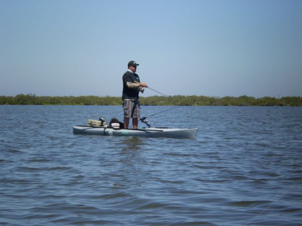 Chuck standing and kayak fishing