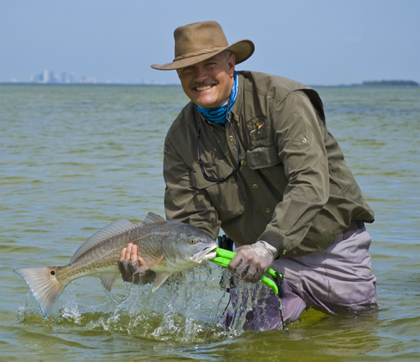 yakangler editor greg becker with a redfish