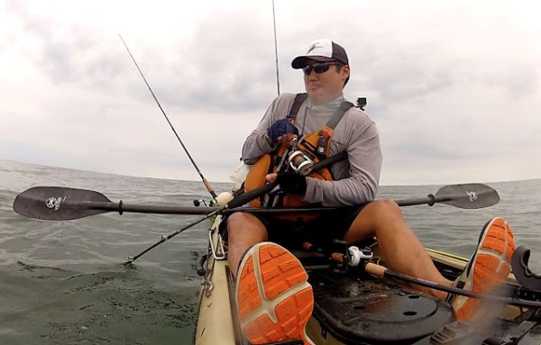 Fighting a huge redfish from a kayak