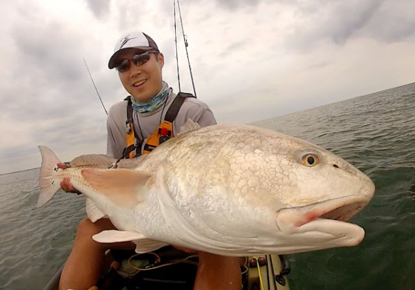 Rob Choi holding a 47.5 inch redfish