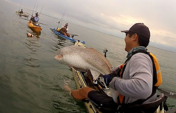 Seth hooks up with a nice redfish