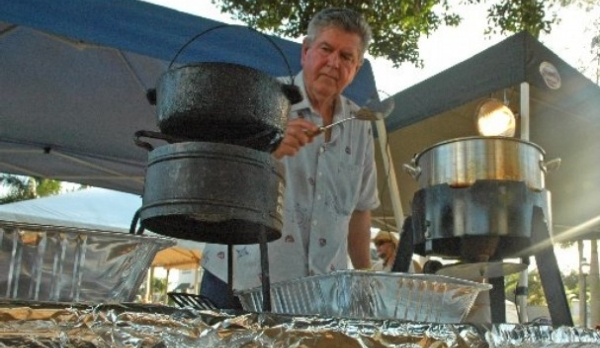 Ron Liles, armed with a metal spatula, waits on for mullet fillets to finish cooking at the Riverfest Fish Fry at Riverside Park in Bonita Springs on Friday. The event, co-sponsored by the City of Bonita Springs, was part of the Calusa Blueway Paddling Festival taking place from Oct. 23 to Nov. 1.