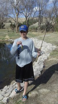 CJ with a small green sunfish