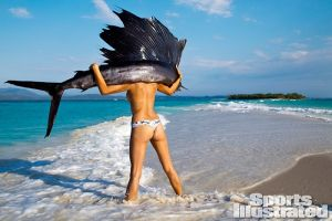 Photograph from Sports Illustrated of Jessica Gomes with a dead sailfish